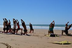 Beachside yoga with Naoko leading the group!   www.SurfBerbere.com