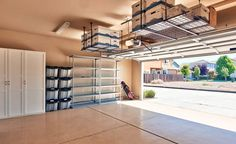 Garage with storage cabinets and overhead ceiling racks
