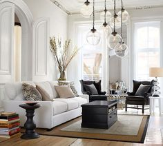 Pottery barn.  White sofa, black leather wing back chairs, sisal/jute rug