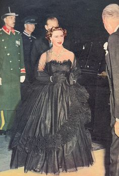 Princess Margaret in Dior. lloks so much like the debut strapless black dress of DIana in her engagement, first royal gala.