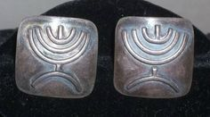 Hey, I found this really awesome Etsy listing at https://www.etsy.com/listing/196671789/vintage-menorah-israel-sterling-silver