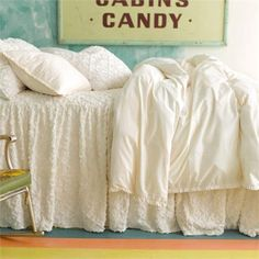 The Classic Ruffle Ivory Duvet Cover from Pine Cone Hill offers a dressed-up vision of traditional ivory bedding.  Your little one will love the petite ruffles and details present in this collection!
