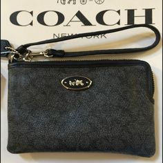 NWT Coach Signature Classy Denim Black Wristlet NWT Coach Signature Denim Black Wristlet. Super Cute and Classy.Comes from a smoke free home. Coach Bags Wallets