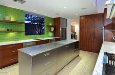 Love the green glass subway tile backsplash!