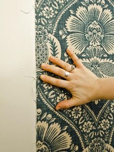 Hanging Starched Fabric Instead of Wallpaper and simply peels off when ready for a change in like wallpaper!