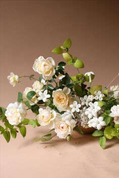 White, creams, and green ethereal centerpiece...