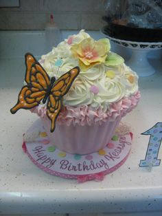 Giant Cupcake Cake with gumpaste flower and chocolate butterfly