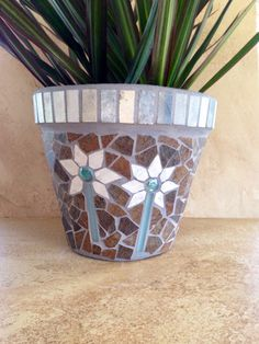 A personal favorite from my Etsy shop https://www.etsy.com/listing/504289566/rustic-mosaic-planter-large-flower-pot