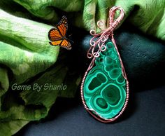 Fantastic Quality malachite pendant wrapped in copper wire by Shanlo Gems