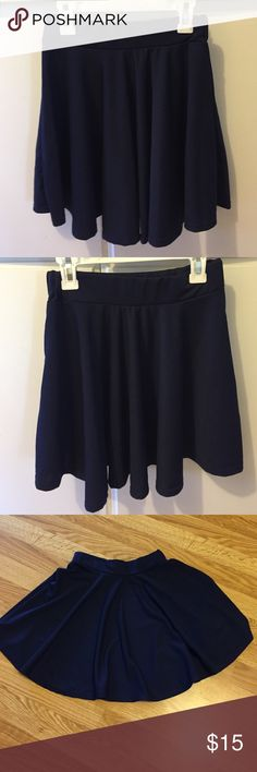 Flirty mini skirt Flirty navy blue mini skirt! Measures 15 inches from top to bottom. Never worn. Skirts Mini