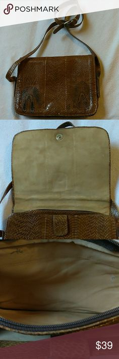 Beautiful  snake like  crossbody bag Inside is very soft. Material like Swede outside is very good condition inside minors wear signs. Is not a brand signed bag....it looks real snake Bags Crossbody Bags