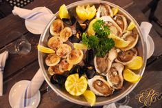 """Start the night with an """"incroyable"""" Seafood Platter. Seasonal oysters, shrimp and clams, Champagne Mignonette and hand-crafted Horseradish remoulade."""