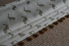 Roman blind, with Pom Pom trim, by Pumblechook Interiors, Scotland. Olive mini hares fabric by Peony and Sage. #hares #linen #interiors