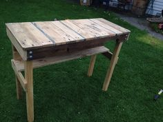 Recycled pallet BBQ table. Rustic and bare timber look. DIY up cycled table with shelf for condiments etc.