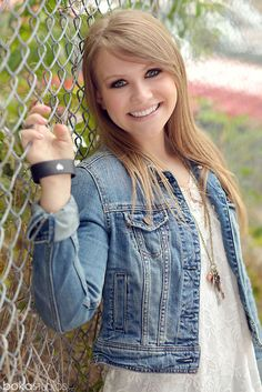 senior girl with chain fence