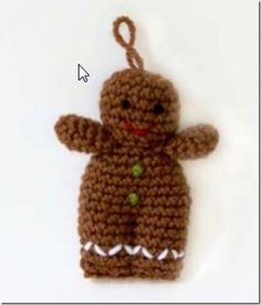 A free pattern for a crochet gingerbread man!! Ornament of package topper.