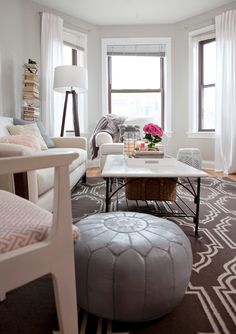 bright and open grays and whites, Moroccan pouf, garden stool, marble coffee table, trellis rug