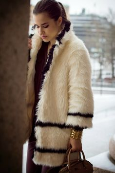 One of my favorite faux fur coats is this special white one from H&M's Paris Autumn Collection!