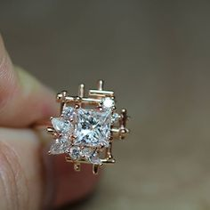 Reminiscent of a French trellis garden this diamond cluster engagement ring is beyond breathtaking!
