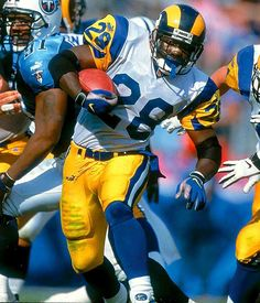 """A key cog of the Rams' """"Greatest Show On Turf,""""Marshall  Faulk played his last game in 2005, ending a career in which he produced 19,154 combined yards from scrimmage. His 6,875 yards receiving are the most by any running back."""