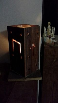 Norse candle box holder. Stained poplar with greyed scrap fencing for the base.