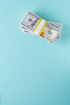 Stacks of 100 dollar bills by Kristin Duvall - Cash - Stocksy United