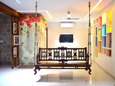 Traditional Styled Wooden Swing Chair with Wooden Partition Wall, Hanging Wall Art & Glazed Coloured Boxes in Wall - GharPedia Wood Bed Design, Foyer Design, Bedroom Bed Design, Home Room Design, Home Interior Design, Living Room Partition Design, Room Partition Designs, Ceiling Design Living Room, Wooden Swing Chair