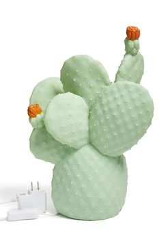 Add a touch of desert flair to your décor with a novelty cactus lamp made from cool, shatterproof vinyl and designed to add a warm glow to any space.