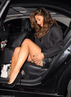 There's an art to it... Nicole Scherzinger gracefully exits her car as she heads to Scott's in Mayfair on Thursday