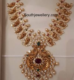 Peacock mango design antique gold medium length nakshi haram studded with rubies,emeralds, cz stones and pearls by sri mahalakshmi gems and jewellers.For details please reach out - sri mahalakshmi gems and jewellers. Indian Wedding Jewelry, Indian Jewelry, Bridal Jewelry, Indian Necklace, Ruby Jewelry, Chain Jewelry, Indian Bridal, Bridal Accessories, Jewelry Sets