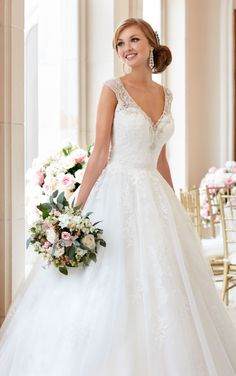 This Diamante-beaded lace and tulle ball gown wedding dress from Stella York boasts a beautiful V-neck line with wide, sparkling shoulder straps. The illusion keyhole back zips up with ease under fabric-covered buttons.