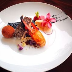 Chia Crusted Sea Bass, Sous Vide Lobster Claw, Dark Beer Sorbet & Deep Fried Lobster Croquettes.