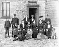 Group of Servants with their dogs, little black kitty and cougar, Ottawa, 1904, by William James Topley, Library and Archives Canada, PA-208448