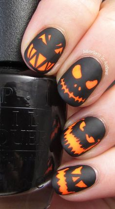 Scary pumpkin head faces Halloween inspired nail art. Add more spook into your Halloween by painting on creepy pumpkin faces on your nails using black and orange nail polish.
