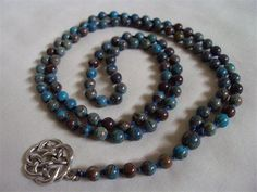 6mm Blue Sky Jasper with Celtic Knot Charm : This mala was hand knotted on blue silk with a use of a celtic knot charm instead of the traditional tassel.
