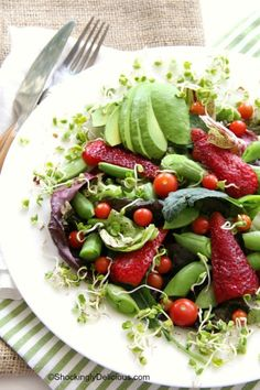 A melange of farmers market finds -- strawberries, sugar snap peas, radish sprouts, cherry tomatoes, avocado -- makes a wonderful Spring Farmers Market Salad. The truffled dressing is divine. Add cooked steak if you like. | ShockinglyDelicious.com #CAonMyPlate #CultivateCA