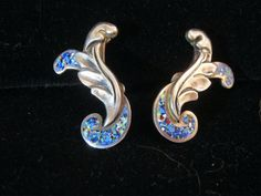 "These Gorgeous Margot de Taxco Sterling Silver & Enamel earrings feature a flowing elegant design with repousse silver & her signature enamel in vivid blue with small flecks of various other colors. They measure 1 1/8"" long by 3/4"" at the widest and have screw backs. Hallmarked one one earring ""Margot de Taxco, 5389"" and ""Sterling Made in Mexico"" with the eagle stamp on the other. They are in good condition with no enamel loss. A fabulous pair o..."