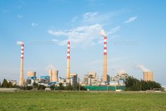large coal-fired power plant by chuyu2014. large power plant with green grass against a blue sky
