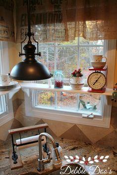 Easy diy floating kitchen window shelves! #debbiedoos