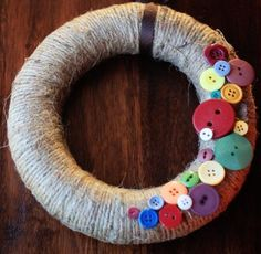 """Fall wreath, with buttons!  I like it!  I was JUST telling Gabriel today that I """"don't do fake leaves and pumpkins."""" ;)"""