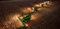 Combines harvesting after dark.  This is awesome.  Poss's used to do this all the time.  Way cool!