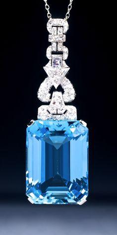 https://www.bkgjewelry.com/emerald-pendant/939-18k-white-gold-emerald-cross-pendant.html A fine Art Deco piece set with a magnificent emerald cut Aquamarine and Diamonds.
