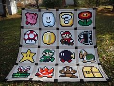 Super Mario Brothers Quilt Finished!!!!! by Jennifer Overstreet | Gable House & Co., via Flickr  Insane!!!!! :)
