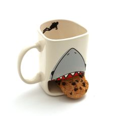 Know someone with a sweet tooth and a love of toothy fish? This is a handmade mug created in my New Jersey studio with all lead free, eco friendly, non toxic materials- kiln fired twice to over 1900 degrees. Safe to place in the dishwasher and microwave. The front of the mug has a special compartment for cookies or biscuits. Those are chocolate chips pictured above. Where did they go? I will just say the shark did not eat them. Inside is a scuba diver, and the back reads LIVE EVERY WEEK…