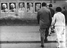 Posters of Nikita Khrushchev, Walter Ulbricht, Wilhelm Pieck and the East German Premier Otto Grotewohl on an East Berlin Wall. (Photo by Ke...