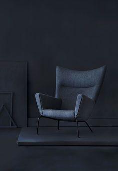 Iconic wingback chair in black by the danish designer Hans J. Wegner.