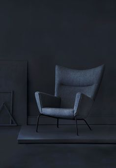 Iconic wingback chair in black by the danish designer Hans J. Wegner.