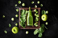 Green smoothie clean eating concept - Healthy green smoothie and ingredients on black background - superfoods, detox, diet, health, Vegan clean eating food concept. Top View