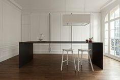 Invisible kitchen. The mystery is not what's hidden behind the panels but where the water from the spigot goes since there is no (deep) basin and no plumbing beneath the tabletop. i29 interior architects, Paris.