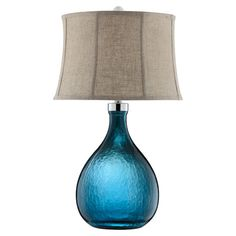 The perfect addition to your living room or master suite, this glass table lamp features a stunning peacock blue finish and a fabric shade. ...